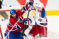 New York Rangers left wing Chris Kreider (20) and Montreal Canadiens defenseman Mike Weaver (43) as the rangers win  7-2 in Game One of the NHL Eastern Conference Finals at theBell Center on Saturday May 17th, 2014 (Andrew Theodorakis/New York Daily News).