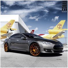 """Exclusive Motoring Worldwide on Instagram: """"Tesla Model S P85 with painted red brake calipers and custom gold finished 22"""" @AGWheels #ExclusiveMotoring"""""""