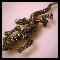 Black metal lizard pin Lizard pin in black metal.  Black crystal accents. Cute addition to any accessory collection. Jewelry Brooches