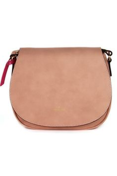 With a sleek saddle shape and suede-like texture, Angela · Roi's Morning crossbody is all about cool minimalism. The compact design boasts a practical back pocket. We speak from experience when we say this vegan style is likely to become your new go-to shoulder bag.    Angela · Roi's pink styles benefit the benefit the Ellie Fund's efforts against breast cancer.