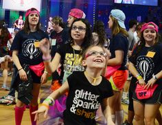 THON kids Mikayla Miller, front, and her sister, Rayeann, toss beach balls with each other and their younger sister, Miranda, as the dancing gets under way Friday night at the Bryce Jordan Center for THON 2014.