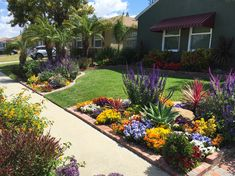 Who said your #home's front walkway has to just be green? #Flower beds are an easy way to add color and to give your #curbappeal a vibrant edge. #PlantingIdeas