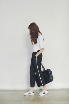 black loose pants with white stripe + white shirt + Adidas superstars white sneakers + bag