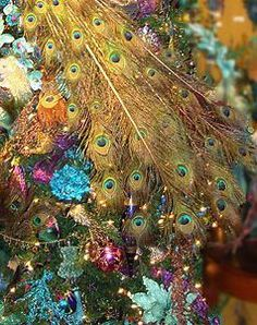Veranda magazine Christmas!!! Bebe'!!! Elaborate tree with decoration in peacock colors and feathers!!!