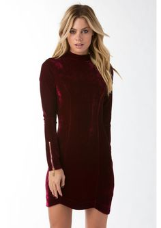 Simply Velveteen Mock Neck Mini Dress || A gorgeous velveteen mini dress. This dress features a mock neck neckline and long fitted sleeves with adjustable zippers for design and fit. Has a single zipper on back for closure. Dress this dress with a clutch and strappy pumps!