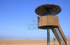 Picture of Man looking through binoculars in a birdwatching tower (Punta del Fangar, Ebro Delta, Spain) stock photo, images and stock photography. Delta Del Ebro, Bird Watching, Binoculars, Playground, Cool Designs, Stock Photos, Building, Inspiration, Ideas Para