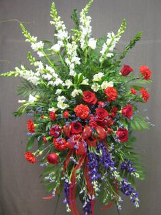 Red, white and blue standing funeral flower tribute. #funeralflowers