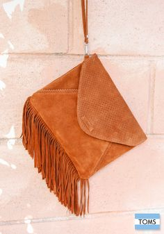 TOMS new fringe clutch will be the perfect addition to your festival wardrobe this summer.