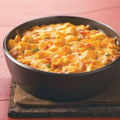 Texan Ranch Chicken Casserole Recipe -Every time I serve this creamy chicken casserole, it gets rave reviews. The recipe was passed down to me and is so good! It's really easy to make, freezes well and has just a touch of heat. If your family likes more, add some jalapenos! —Kendra Doss, Smithville, Missouri