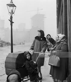 February A group of women and children stop to look at across the street where sections of the notoriously squalid slums known as the Gorbals have been demolished. The Gorbals, Pram Stroller, Glasgow Scotland, Slums, Strollers, Liverpool, February, That Look, Parents