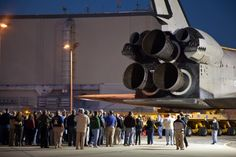 News Watch » StarStruck    Employees of Kennedy Space Center who worked with Atlantis for over 26 years walk behind her as she rolls past the Orbiter Processing Facilities that housed her for that time. Photo Credit: Jon Brack