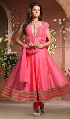 Get yourself drenched with praises shower while walk out donning this salmon color chanderi silk embroidered Anarkali churidar suit. This attire is effectively created with lace, patch, resham and sequins work. #LovelyPinkReshamEmbroideredSilkAnarkali