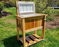All weather 48-QT Rustic Cedar Chest Cooler Stand with Brass | Etsy Wood Cooler, Cooler Cart, Patio Cooler, Cooler Stand, Ice Chest Cooler, Wine Chiller Bucket, Bourbon Barrel, Barrel Bar, Serving Table