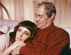 Actor Elizabeth Taylor leans her head against Rex Harrison's shoulder in a still from the film, 'Cleopatra,' directed by Joseph Mankiewicz, 1963. Photo: 20th Century Fox, Getty Images / Hulton Archive