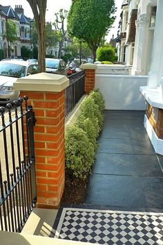Railing & hedges - victorian front garden design london red rubber brick wall with yellow composite pier cap and mosaic tile path and paving Garden Design London, Rock Garden Design, London Garden, Walled Garden, Terrace Garden, Garden Paths, Garden Fences, Small Front Gardens, Back Gardens