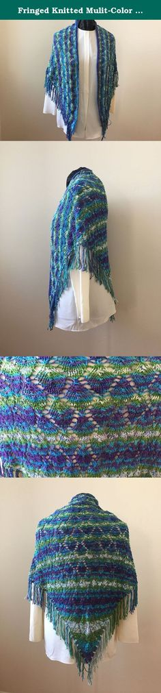 Fringed Knitted Mulit-Color Shawl. Fringed, hand-knitted shawl in a leaf pattern. Made of acrylic sock yarn, which makes it extremely soft, in aqua, purple, and green. Perfect for everyday and special occasions. Hand wash cold. Lay flat to dry. 62 inches point-to-point. 32 inches from neckline down the center back.