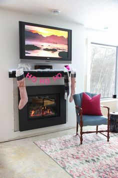 Candy Pink Christmas Inspiration! Holiday home tour with Canadian Bloggers. Flocked tree and custom paper house ornaments, metal fireplace mantel, karlstadt sectional, pink urban barn rug. Decorated wooden staircase and custom iron railings. Traditional Christmas tree mixed with a pink holiday tree. DIY sewn stockings and buffalo check details. Fa la la la la!