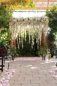 rustic white flowers wedding arch