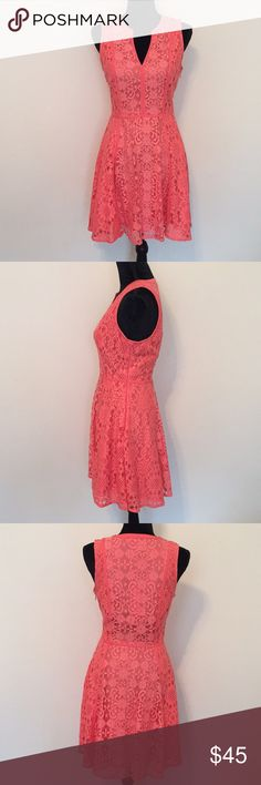 Lauren Conrad Dress Beautiful coral color dress with lace print pattern. It has a fit and flare shape with side zip closure. New condition. Offers welcomed. LC Lauren Conrad Dresses Midi