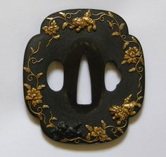 Shishi (lion-dog) nanako (cod-roe) tsuba. Beautiful work.