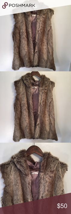 WD•NY Faux Fur Vest Like me new faux fur vest by WD•NY. Hooded vest with claps. Side pockets. No size tag/cleaning instructions. Measurements fit size XL according to product size chart. See last photo for dimensions. Dry clean according to product page. WDNY Jackets & Coats