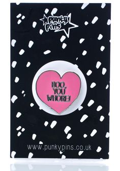 """Punky Pins Mean Gurl Pin .. for when they don't keep it real. Throw that Regina shade with this precious heart shaped enamel pin that famously reads, """"boo, you whore!"""" with classic pin back closure."""