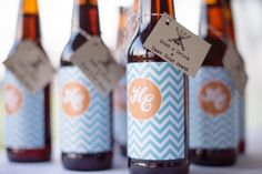 home brew made by the Groom used as escort cards |  Photography by paperantler.com |   Read more - http://www.stylemepretty.com/2013/07/01/thompson-island-massachusetts-wedding-from-paper-antler-photography/