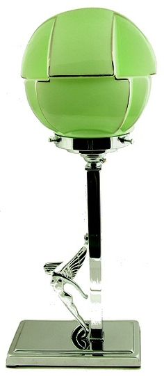 1930's Art Deco table lamp, featuring all chrome body with a stylised female nude with wings leaning forward. To finish off a very desirable green coloured glass shade in the most fantastic geometric shape.