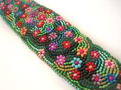 Multicolor Flowers on Green - Fresh Spring Romantic Bead Embroidered Bracelet. Ft36,900.00, via Etsy.