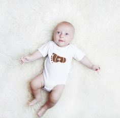 Luc&Lou Football onesie. Show off your little athlete in this allstar football onesie. This one will surely score a TOUCHDOWN!! For every onesie purchased, another onesie is donated to a baby in need. www.lucandlou.com  #lucandlou #2babies2smiles #NICUgrad #boys #football #onesies @onesie #gift #toddler #oneforone #babyshower