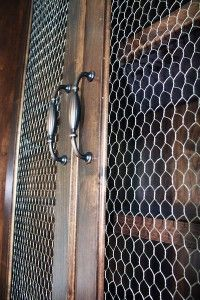 French Country Home Inspiration - Chicken wire as windows in the cabinets.   Check out Magruderhomes.com