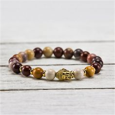 Featured Stones: Mookaite Jasper, Gold Glide through the day with ease and connect with the electromagnetic energy currents of the Earth. Let this bracelet be y Buddha Beads, Mala Meditation, Stone Jewelry, Jasper, Beaded Bracelets, Pendant, Gold, Stones, Collection