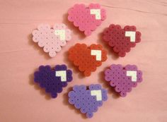 Give your refrigerator a little love this February with this 7-piece set of Perler Bead heart magnets!    Various shades of red, pink, and