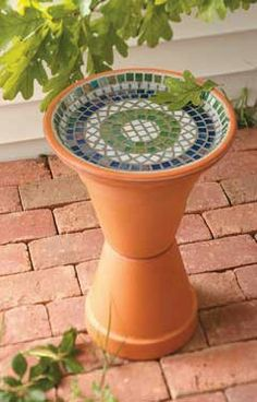 Mosaic bird bath from terra cotta pots