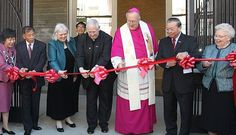 Bishop Robert McElroy of San Francisco (center) and Father Daniel McCotter, CSP, (center left) join in the ribbon cutting ceremony of St. Mary's School and Chinese Catholic Center in San Francisco's Chinatown neighorhood May 2.