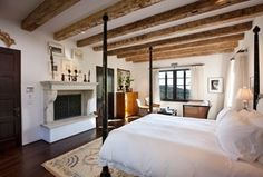 Traditional Master Bedroom with Hardwood floors, Built-in bookshelf, Cement fireplace, Exposed beam, metal fireplace