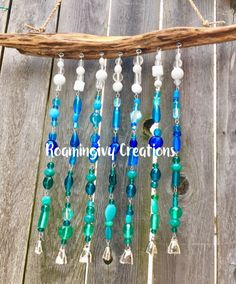 Handmade wreaths, drift wood chimes and dream catchers. Diy Wind Chimes, Glass Wind Chimes, Mobiles, Driftwood Projects, Driftwood Ideas, Driftwood Art, Dollar Tree Decor, Beaded Curtains, Wire Crafts