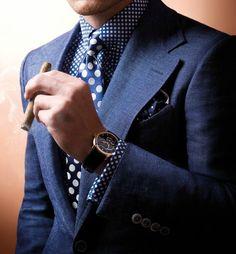 Polka dot shirt and tie.