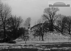 The Grave Creek mound in Moundsville, West Virginia once was surrounded by a ditch. Best described as a Bowl Barrow.