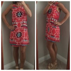 """EUC Pink Aztec Print Dress So Cute! Excellent used condition! Only worn one time. Pink Aztec Print Dress with cream, teal and purple colors.  This dress is so cute and comfy, makes a perfect spring and summer dress!  The dress is chiffon material and does have lining. Shell 100% polyester lining 100% polyester.  Length 31"""" Xhilaration Dresses"""