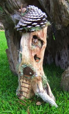Love the use of an upside down pinecone as a roof. Lots for great ideas for fairy houses here.