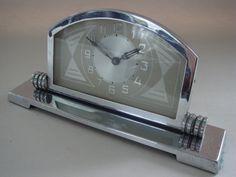 GERMAN ART DECO ARCH-TOP CHROME MECHANICAL SHELF CLOCK WITH GEOMETRIC DESIGN ON FACE