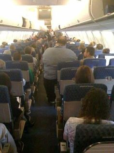 Heavy Airline Passenger Taking Up One Seat and the Whole Aisle ---- funny pictures hilarious jokes meme humor walmart fails