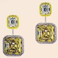 repost from @sharpjewelsny GIA certified ear pendants mounted with colorless square emerald cut diamond tops, 4.34 carats, suspending an exceptionally rare and well matched pair of square emerald cut diamonds: 35.90 carats, Natural Fancy Intense Yellow Color.