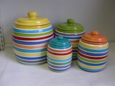 Set of 4 Bright Rainbow and White Hand Painted Striped Ceramic Kitchen Canisters. $140.00, via Etsy.
