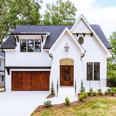This home is beaming with character from the garage doors to the black windows! With an exterior this gorgeous I can't wait for you to… Farmhouse Homes, Modern Farmhouse, Farmhouse Design, Modern Cottage Style, Modern Craftsman, White Farmhouse, Farmhouse Ideas, Modern Country, Casas Containers