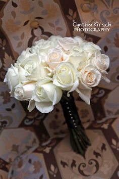 Sweet White Rose wedding bouquet.love it but with a satin ribbon around the stems with a diamond pin