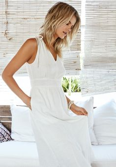 A white cotton dress paired with flat sandals is an easy, effortless look to show off your tan. Check out my top 10 fav summer white dresses White Dress Summer, Cotton Dresses, Wedding Dresses, Pretty, Sweaters, How To Wear, Hair, Outfits, Tops