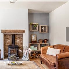 Modern rustic cosy living room fireplace wood burning stove oak mantel Modern rustic co Brown Living Room Decor, Living Room Color, Living Room Modern, Wood Burning Stoves Living Room, New Living Room, Trendy Living Rooms, Cottage Living Rooms, Brown Living Room, Cosy Living Room