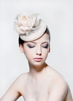 Ivory sinamay headpiece with silk roses by RoseYoungMillinery, £145.00